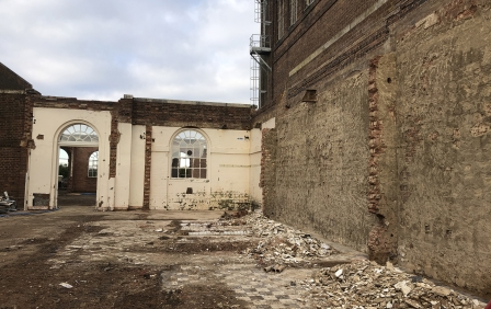 Uncovering wall facades